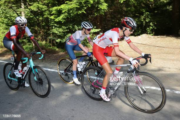 Trinidad and Tobago's Teniel Campbell , Britain's Anna Shackley and Japan's Hiromi Kaneko ride during the women's cycling road race of the Tokyo 2020...