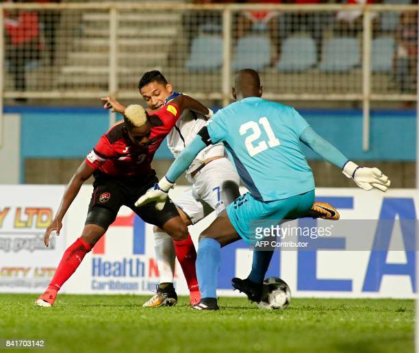 Trinidad and Tobago's Willis Plaza, Honduras' defender Henry Figueroa and Trinidad and Tobago's goalkeeper Jan Michael Williams vie for the ball...