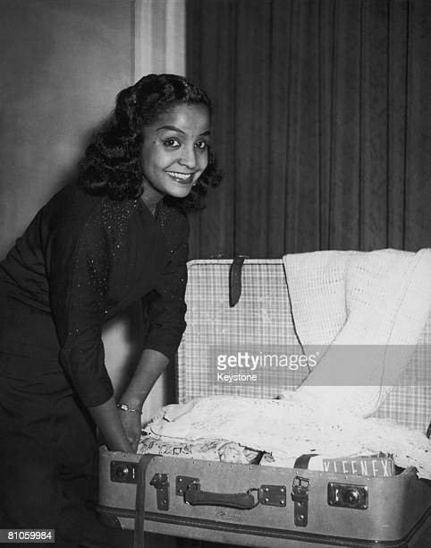 Trinidadborn singer Mona Baptiste prepares to leave Hamburg for a visit to London 13th September 1956