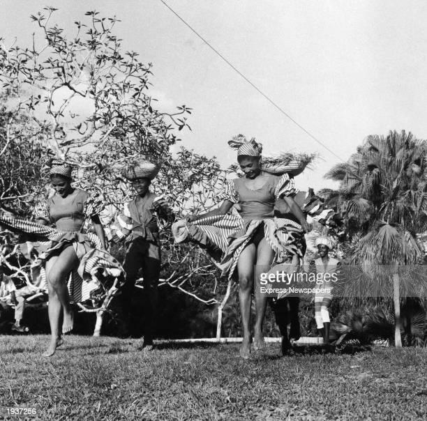 Trinidadian dancers perform outdoors on a lawn PortofSpain Trinidad April 24 1958