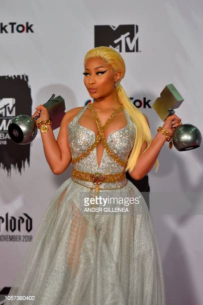 TrinidadianUS rapper Nicki Minaj poses backstage with her awards during the MTV Europe Music Awards at the Bizkaia Arena in the northern Spanish city...