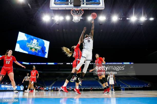 Trinity Baptiste of the Arizona Wildcats drives to the basket ahead of Hailey Zeise of the Stony Brook Seawolves during the second half in the first...