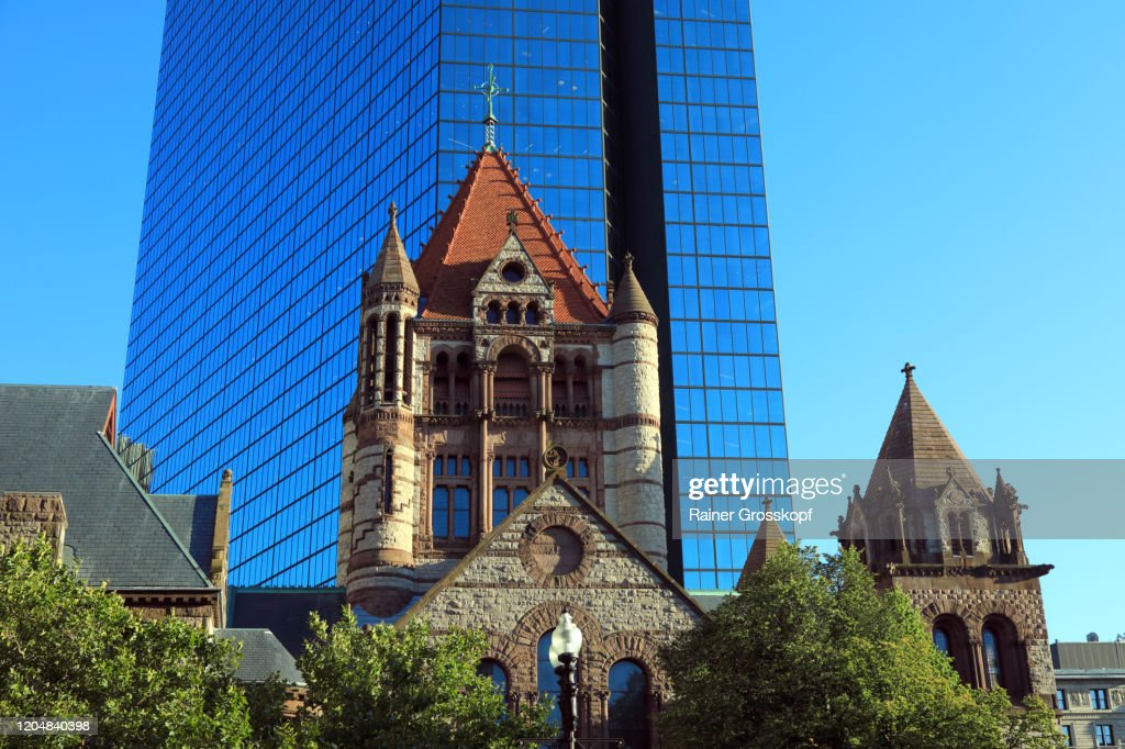 Trinity Church in front of the shiny metallic facade of 200 Clarendon, the former John Hancock Tower : Stock Photo