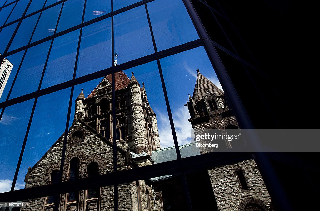 Trinity Church is reflected on the side of a building in Boston, Massachusetts, U.S., on Monday, Aug. 6, 2012. Harvard University, an American private Ivy League research university established in 1636, is the oldest institution of higher learning in the United States and the first corporation chartered in the country. Photographer: Brent Lewin/Bloomberg via Getty Images