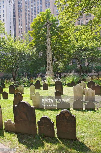 trinity churchyard, with monuments honoring memory of notable new yorkers buried there, ny, ny, usa - alexander hamilton stock photos and pictures