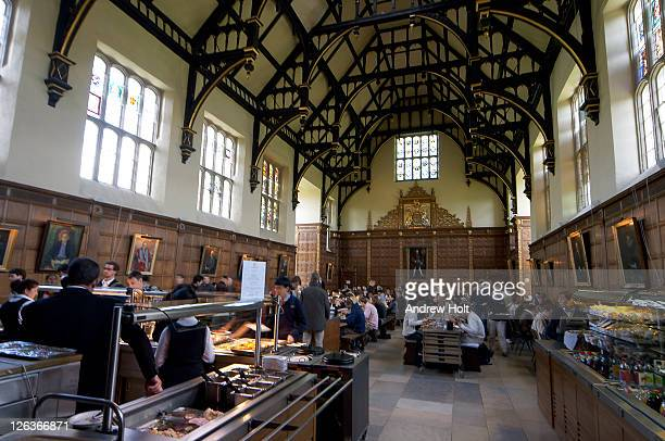 Trinity College Dining Hall, Cambridge. As with many other Trinity things, this is the largest dining hall in Cambridge. A large picture of Henry VIII dominates the room at the end where Fellows (senior members of the college) eat on a raised dais. Trinity