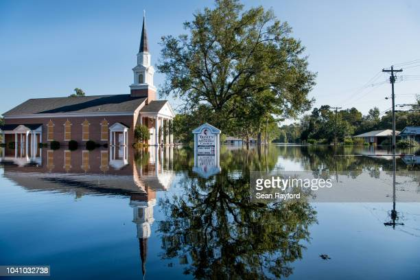 Trinity United Methodist Church is inundated by floodwaters caused by Hurricane Florence near the Crabtree Swamp on September 26, 2018 in Conway,...