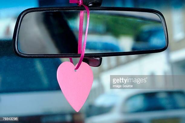 A trinket hanging on a rearview mirror