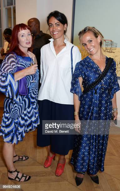 Trino Verkade Zia Zareem Slade and guest attend the Bansky 'Greatest Hits 20022008' exhibition VIP preview at Lazinc on July 9 2018 in London England