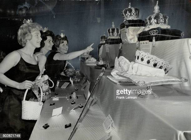 Trio entranced by display of crown jewels are Mrs Maurice Anderson Mrs Arthur Patterson and Mrs A S Waldman members of the junior opera committee...