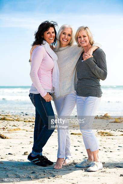 Trio of beautiful mature women at the beach