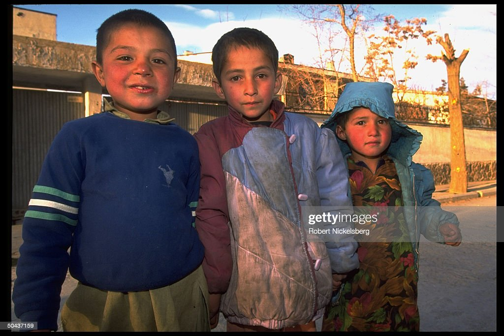 Trio of children out on street in civil : News Photo