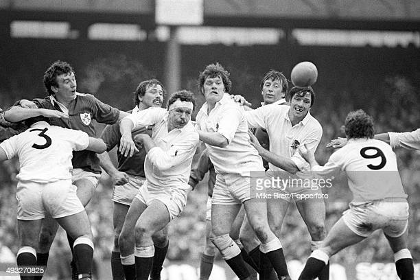 A trio of England forwards Bill Beaumont Fran Cotton and Nigel Horton get the ball back to scrumhalf Steve Smith during the Five Nations...