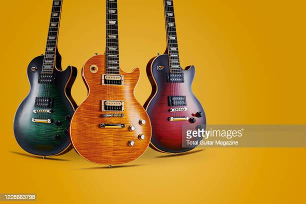 A trio of Gibson Slash Les Paul Standard electric guitars including a Limited Edition Ananconda Burst Appetite Burst and Limited Edition Vermillion...