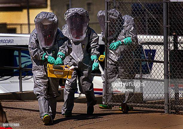 A trio of Los Angeles city firefighters in full Haz Mat suits make their way out of the US Post Office on Beacon Street in San Pedro a post office...