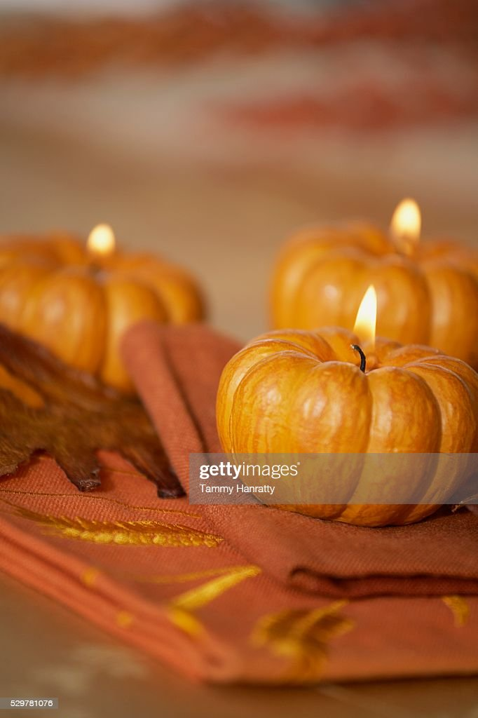 Trio of Pumpkin Candles : Stock Photo