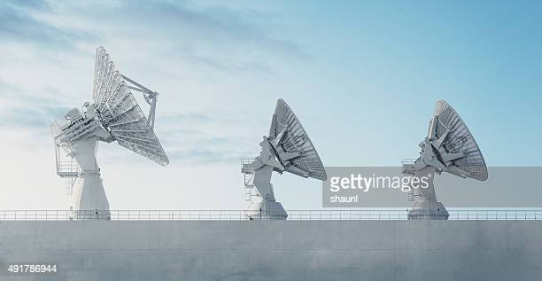 trio of satellite dishes - receiver stock pictures, royalty-free photos & images