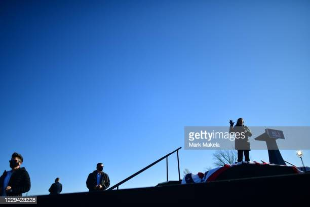 Trio of Secret Service agents monitor activity as Sen. Kamala Harris speaks at a drive-in rally on the eve of the general election on November 2,...