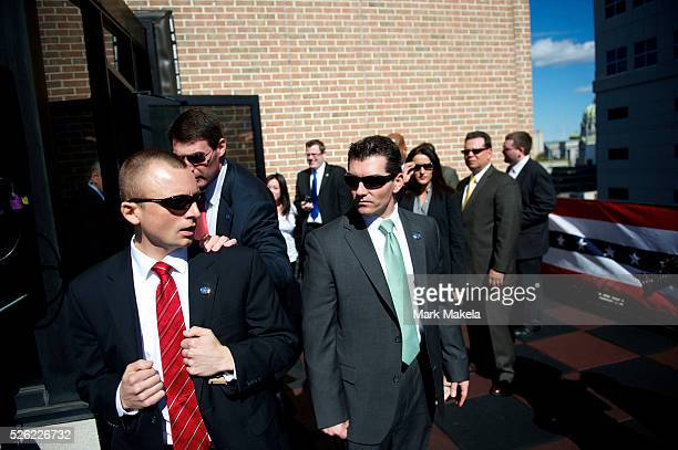 A trio of secret service monitor the rooftop moments after Republican Presidential candidate Mitt Romney departed during the Pennsylvania campaign...