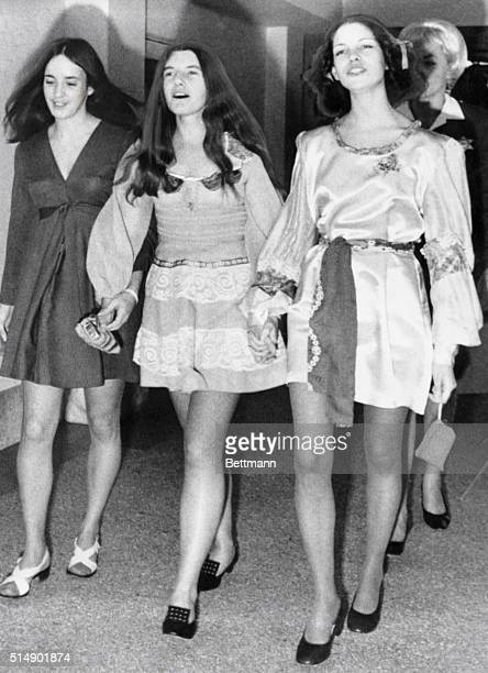 A trio of suspects in the Sharon Tate murder case sing as they march to court for a hearing Left to right Susan Atkins Patricia Krenwinkel and Leslie...