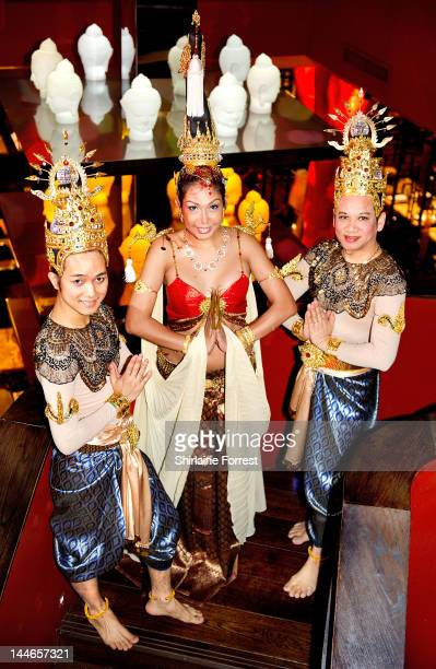 A trio of traditional Thai Ladyboys pose for the cameras during a rehersal at Cinnabar on May 17 2012 in Manchester England The Ladyboy dancers will...