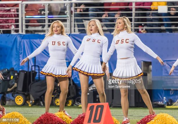 A trio of USC Trojans cheerleaders celebrate the win during the PAC12 Championship game between the USC Trojans and the Stanford Cardinals on Friday...