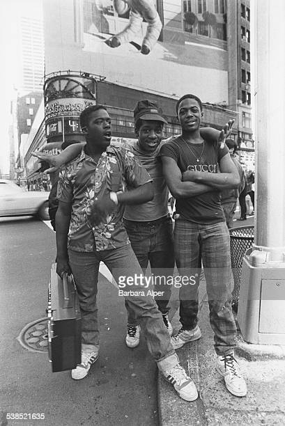 A trio of young men in Times Square New York City March 1987