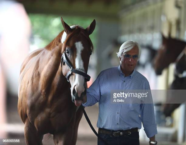 Triple Crown and Belmont Stakes contender Justify is walked in his barn by trainer Bob Baffert after arriving prior to the 150th running of the...
