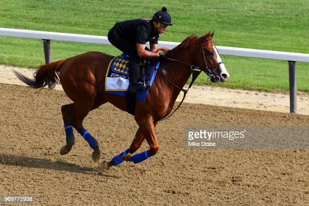 Triple Crown and Belmont Stakes contender Justify trains with Humberto Gomez up prior to the 150th running of the Belmont Stakes at Belmont Park on...