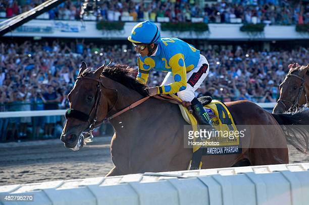 Triple Crown Winner American Pharoah ridden by Victor Espinoza wins The William Hill Haskell Invitational at Monmouth Park on August 2, 2015 in...