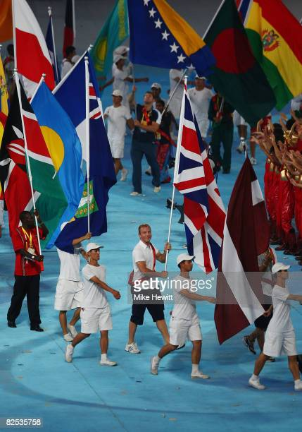 Triple Gold medalist and track cyclist Chris Hoy carries the flag for Great Britain during the Closing Ceremony for the Beijing 2008 Olympic Games at...