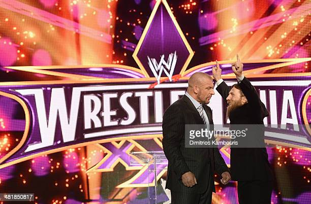 Triple H and Daniel Bryan attend the WrestleMania 30 press conference at the Hard Rock Cafe New York on April 1 2014 in New York City