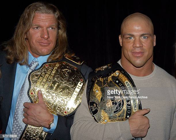 Triple H and Kurt Angle get together with their championship belts at the ESPN Zone restaurant for a WWE news confernce to announce details of...