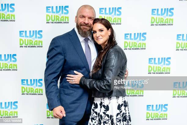 Triple H and Stephanie McMahon visit The Elvis Duran Show to discuss the all woman Evolution WWE event at the Nassau Coliseum at Z100 Studio on...