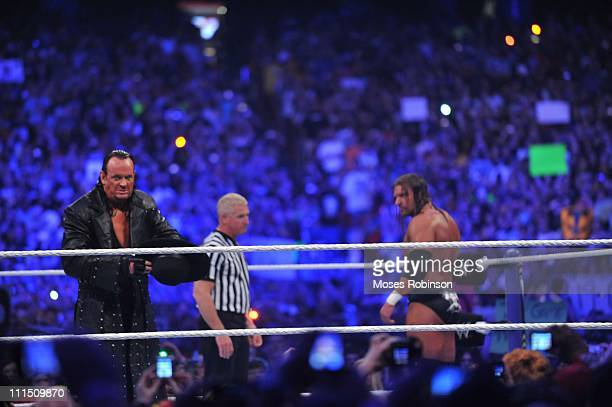 Triple H and Undertaker battle during their WWE No Holds Barred Match at 'WrestleMania 27' at the Georgia World Congress Center on April 3 2011 in...