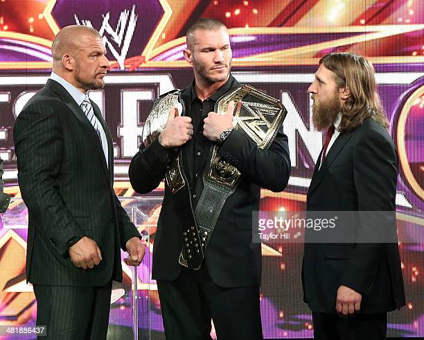 Triple H Randy Orton and Daniel Bryan attend the WrestleMania 30 press conference at the Hard Rock Cafe New York on April 1 2014 in New York City