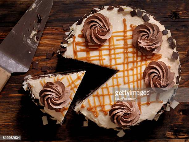 triple layer chocolate caramel cake - chocolate cake above stock pictures, royalty-free photos & images
