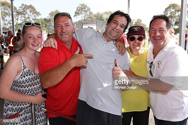 Triple M radio host Mick Molloy poses with Tyabb Football and Cricket Club members during the Luke Batty Memorial at Tyabb Football Netball Club on...