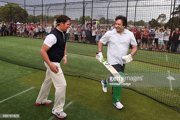 Triple M radio host Mick Molloy prepares to face Australian cricket legend Shane Warne in the nets during the Luke Batty Memorial at Tyabb Football...