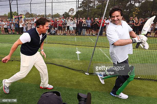 Triple M radio host Mick Molloy reacts as Australian cricket legend Shane Warne looks to through a ball into his backside in the nets during the Luke...