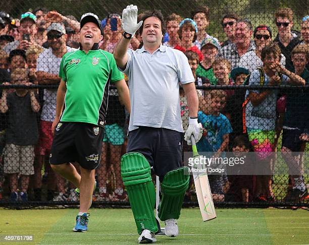 Triple M radio host Mick Molloy reacts in front of Mornington Peninsula cricketing legend Jason Mathers after facing bowling by Australian cricket...