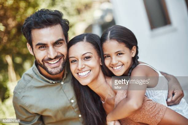 triple times the happiness in our family - latino stock photos and pictures
