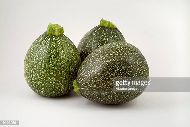triple courgettes - marrow squash stock pictures, royalty-free photos & images