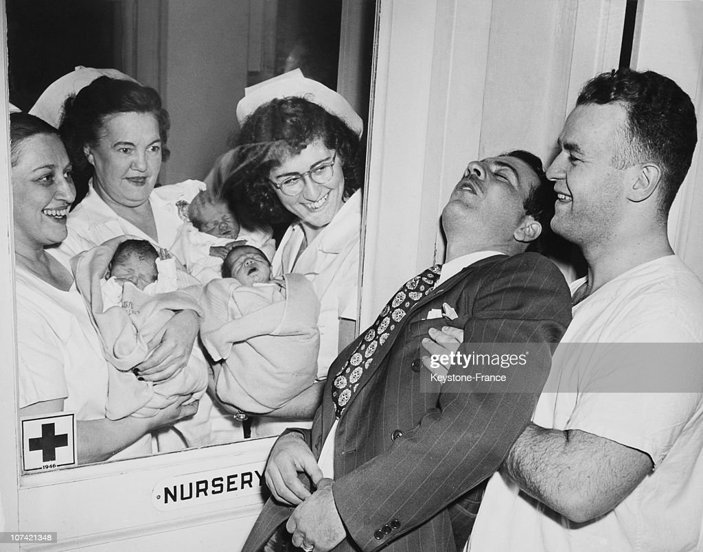Triplets And Their Unconscious Father At New York In Usa On 1946 : News Photo
