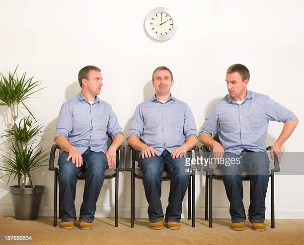 triplets in a waiting room - cloning stock pictures, royalty-free photos & images