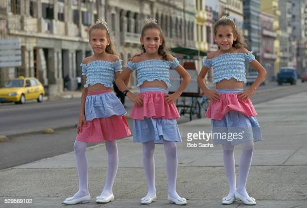triplets wearing matching outfits - little girls in pantyhose stock pictures, royalty-free photos & images