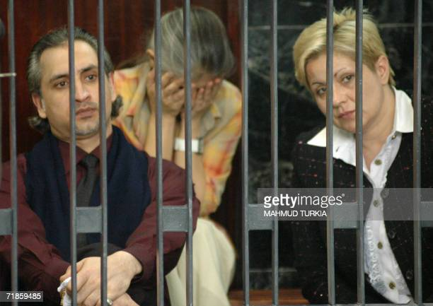 Foreign medics Bulgarian Nasia Nenova and Snezana Dimitrova and Palestinian Ashraf Hajjuj follow the court hearing from behind the bars during their...