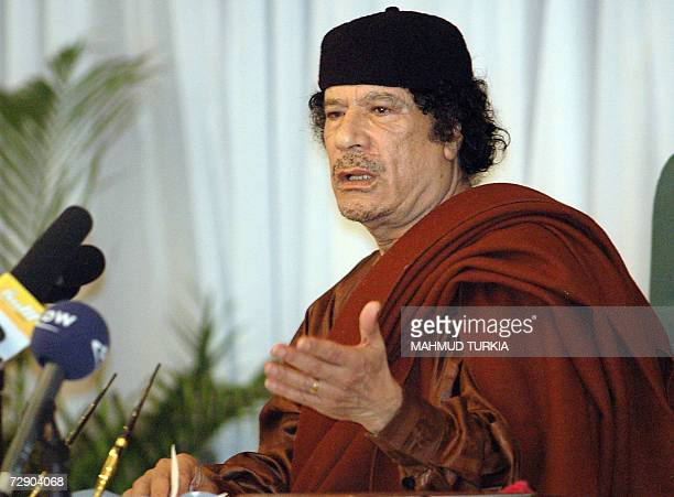 Libya's leader Moamer Khadafi meets with religious representatives in Tripoli 29 December 2006 Libya today declared three days of national mourning...