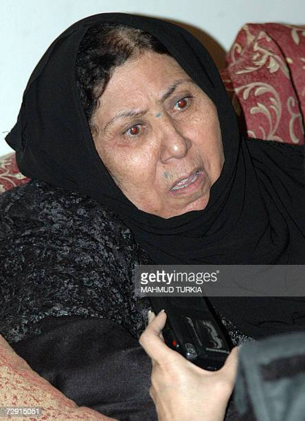 The halfsister of Iraq's late leader Saddam Hussein Amal Ibrahim alTikriti talks to AFP at her apartment in the Libyan capital Tripoli 03 January...
