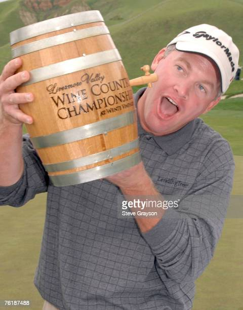 Tripp Isenhour pretends to take a drink from the spiget of the Wente Vineyards Winner's Trophy, a minature barrell of wine after his victory in the...